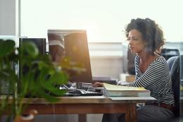 woman at computer in office
