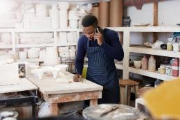 Pottery Studio Owner on phone taking notes