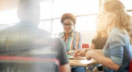 Woman listening to colleague in meeting